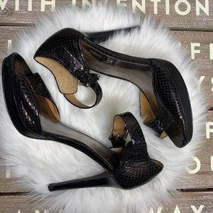 Coach stilettos Sistine python black heels size 7B